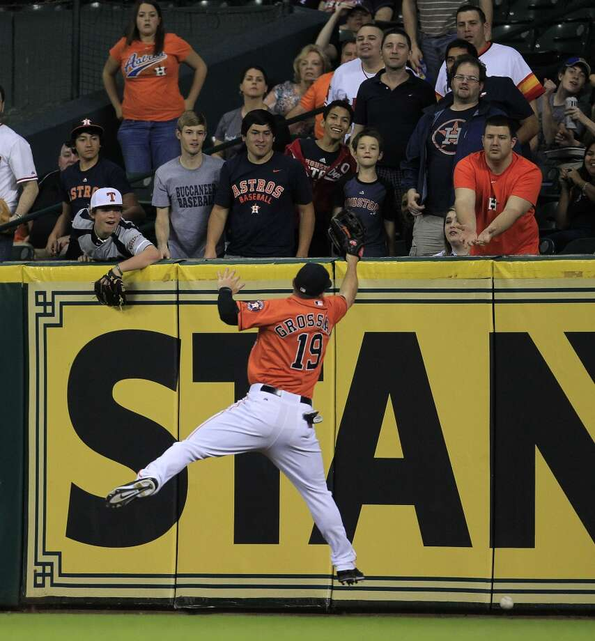 Astros left fielder Robbie Grossman tries to catch Angels catcher Chris Iannetta's double off the outfield wall. Photo: Karen Warren, Houston Chronicle