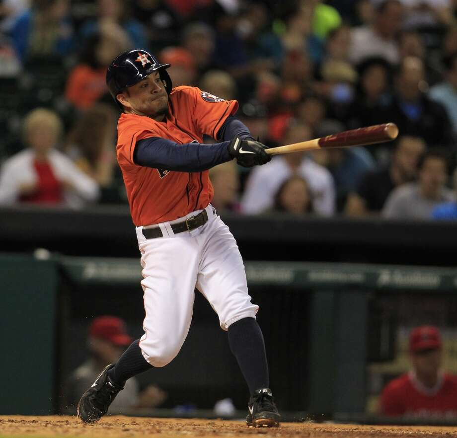Astros second baseman Jose Altuve hits a single. Photo: Karen Warren, Houston Chronicle