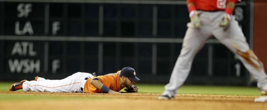 Marwin Gonzalez lies on the ground after missing a single hit by Angels first baseman Albert Pujols. Photo: Karen Warren, Houston Chronicle