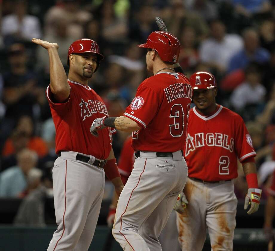 Angels left fielder Josh Hamilton celebrates after his three-run home run with teammate Albert Pujols. Photo: Karen Warren, Houston Chronicle