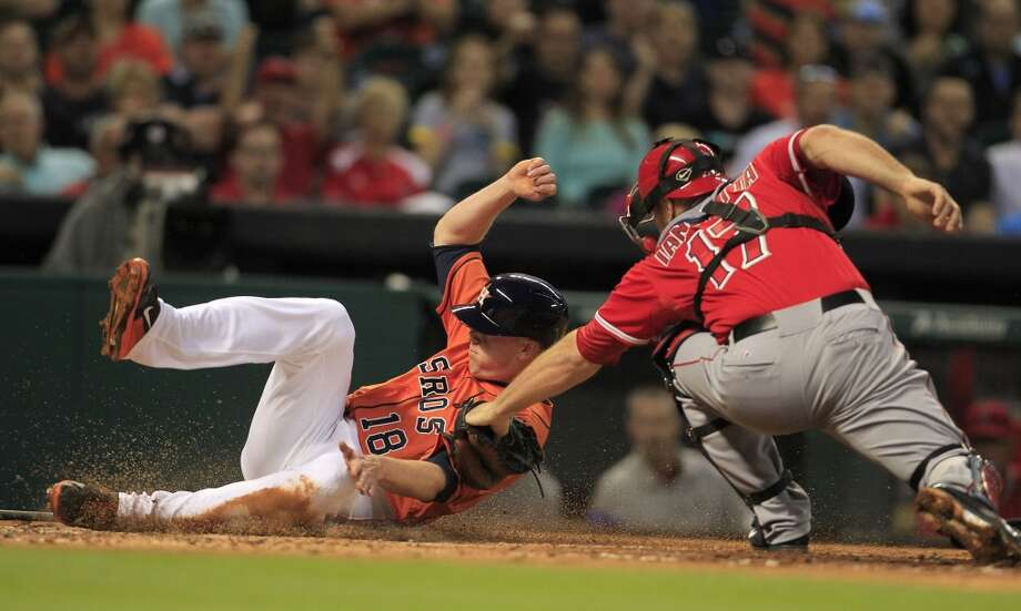 Astros left fielder Marc Krauss is tagged out at home plate by Angels catcher Chris Iannetta. Photo: Karen Warren, Houston Chronicle