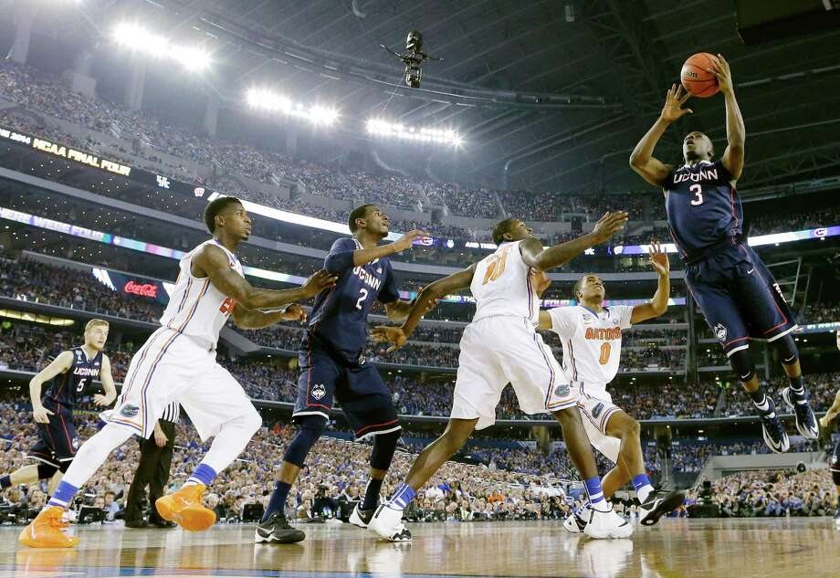 Connecticut guard Terrence Samuel (3) shoots against Florida during the second half of the NCAA Final Four tournament college basketball semifinal game Saturday, April 5, 2014, in Arlington, Texas. Photo: Eric Gay, AP / Associated Press