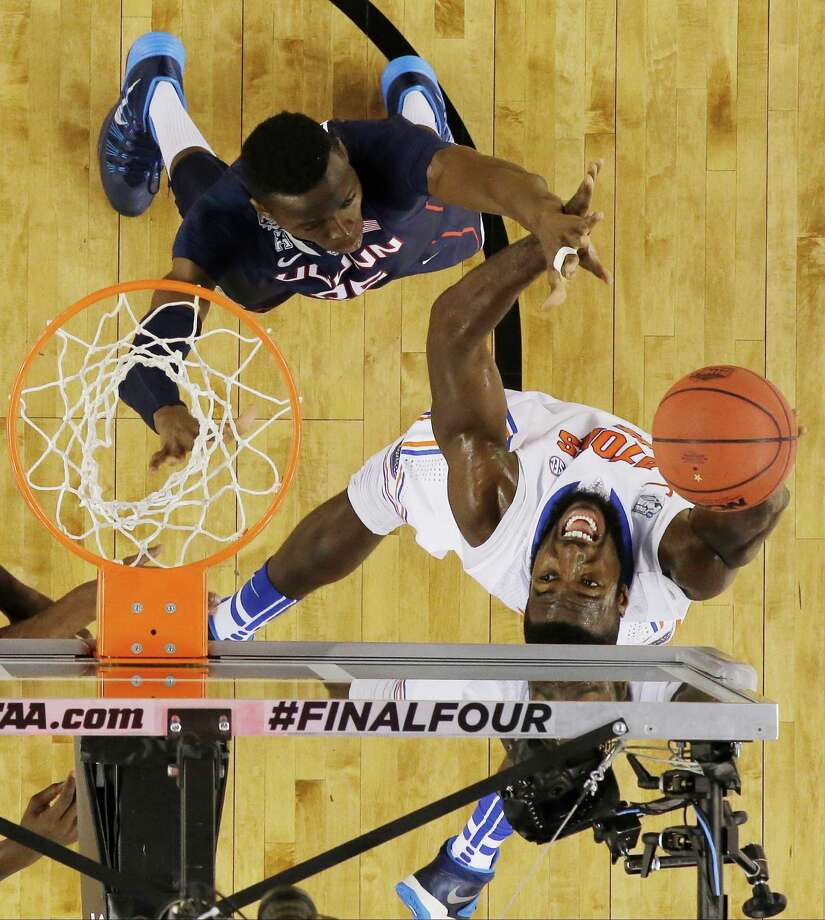 Florida center Patric Young (4) shoots as Connecticut center Amida Brimah (35) defends during the second half of the NCAA Final Four tournament college basketball semifinal game Saturday, April 5, 2014, in Arlington, Texas. Photo: David J. Phillip, AP / Associated Press