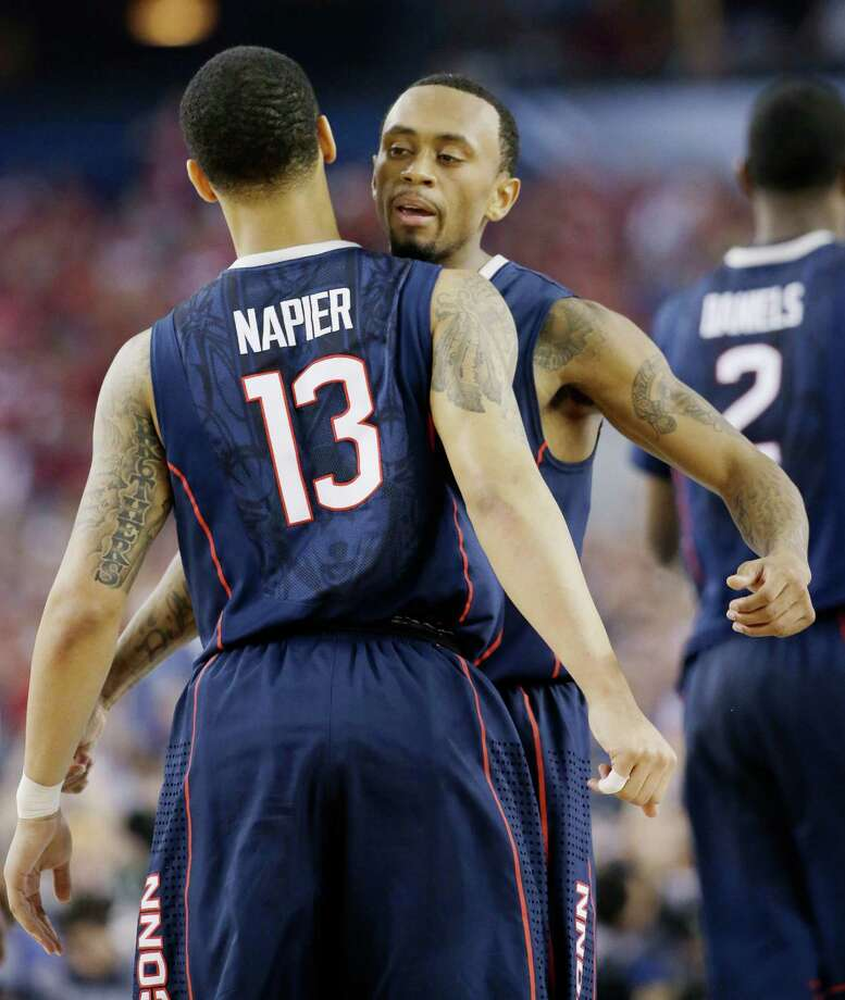 Connecticut guard Shabazz Napier (13) and guard Ryan Boatright celebrate during the second half of the NCAA Final Four tournament college basketball semifinal game Saturday, April 5, 2014, in Arlington, Texas. (AP Photo/David J. Phillip) Photo: David J. Phillip, ASSOCIATED PRESS / Associated Press