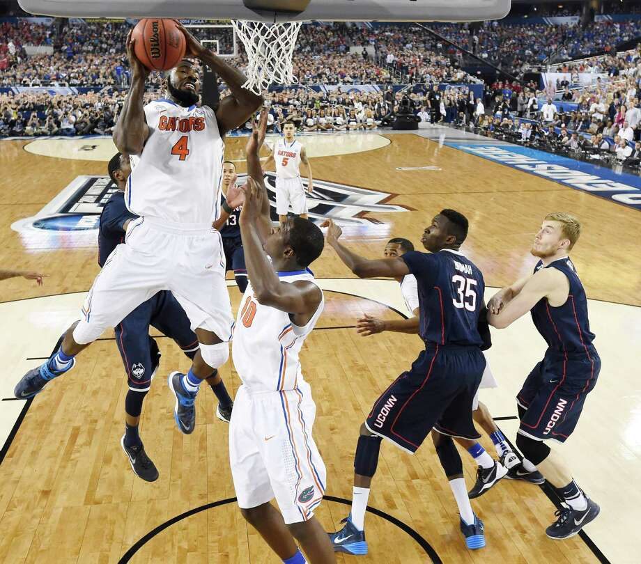 Florida center Patric Young (4) rebounds the ballagainst Connecticut during the second half of the NCAA Final Four tournament college basketball semifinal game Saturday, April 5, 2014, in Arlington, Texas. Photo: Chris Steppig, AP / Associated Press
