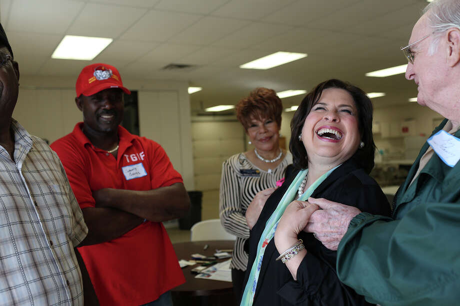 State Sen. Leticia Van de Putte cuts up with Roy Stanley, right, a former county commissioner; ShirleyMcKellar, center, and Johnny W. Gross as she campaigns in Tyler. She visited Houston on Saturday in her statewide fund-raising quest. Photo: Lisa Krantz, Staff / SAN ANTONIO EXPRESS-NEWS