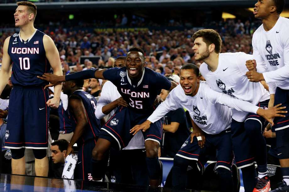 ARLINGTON, TX - APRIL 05:  The Connecticut Huskies bench reacts during the NCAA Men's Final Four Semifinal against the Florida Gators at AT&T Stadium on April 5, 2014 in Arlington, Texas. Photo: Ronald Martinez, Getty Images / 2014 Getty Images