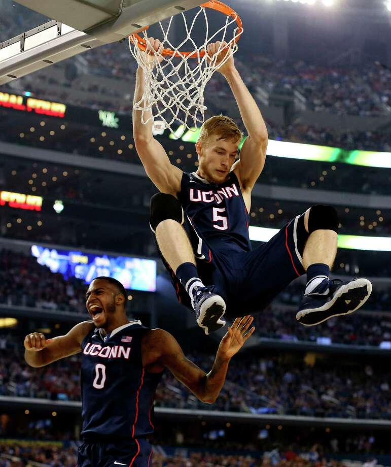 ARLINGTON, TX - APRIL 05:  Niels Giffey #5 of the Connecticut Huskies dunks against the Florida Gators during the NCAA Men's Final Four Semifinal at AT&T Stadium on April 5, 2014 in Arlington, Texas. Photo: Ronald Martinez, Getty Images / Getty Images