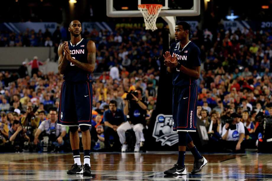 ARLINGTON, TX - APRIL 05: Phillip Nolan #0 and DeAndre Daniels #2 of the Connecticut Huskies celebrate during the NCAA Men's Final Four Semifinal against the Florida Gators at AT&T Stadium on April 5, 2014 in Arlington, Texas. Photo: Ronald Martinez, Getty Images / Getty Images