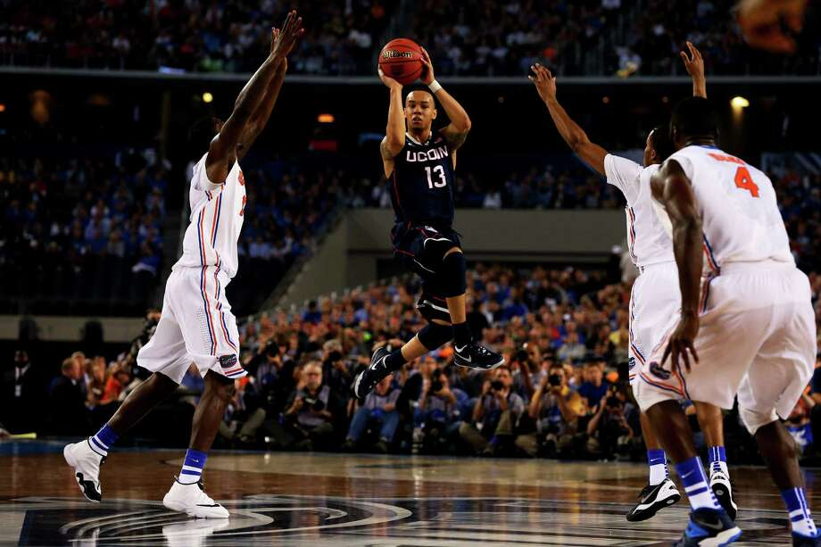 ARLINGTON, TX - APRIL 05: Shabazz Napier #13 of the Connecticut Huskies looks to pass against the Florida Gators during the NCAA Men's Final Four Semifinal at AT&T Stadium on April 5, 2014 in Arlington, Texas. Photo: Ronald Martinez, Getty Images / Getty Images