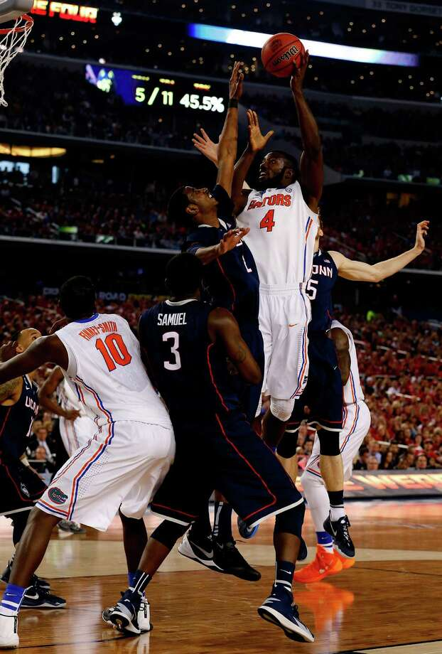 ARLINGTON, TX - APRIL 05: Patric Young #4 of the Florida Gators goes up for a shot as DeAndre Daniels #2 of the Connecticut Huskies defends during the NCAA Men's Final Four Semifinal at AT&T Stadium on April 5, 2014 in Arlington, Texas. Photo: Tom Pennington, Getty Images / Getty Images