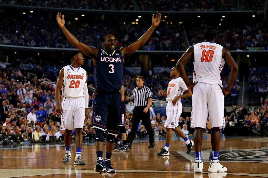 ARLINGTON, TX - APRIL 05: Terrence Samuel #3 of the Connecticut Huskies celebrates after defeating the Florida Gators 63-53 in the NCAA Men's Final Four Semifinal at AT&T Stadium on April 5, 2014 in Arlington, Texas. Photo: Ronald Martinez, Getty Images / Getty Images