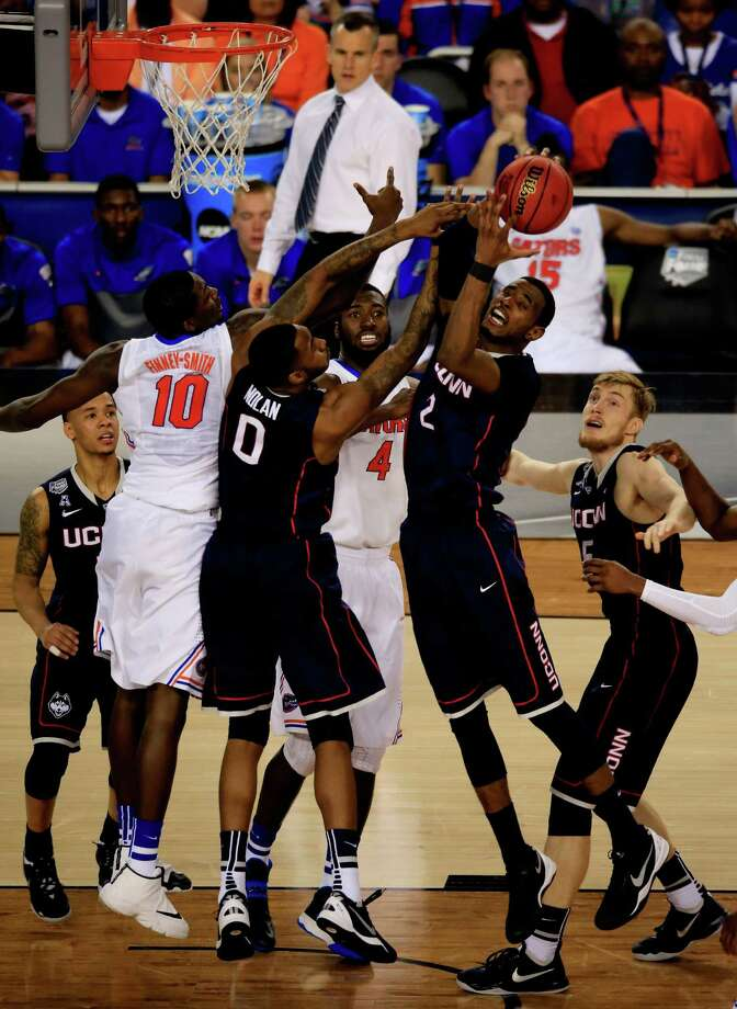 ARLINGTON, TX - APRIL 05: Tyler Olander #10 of the Connecticut Huskies battles for a rebound against Phillip Nolan #0 and DeAndre Daniels #2 of the Connecticut Huskies during the NCAA Men's Final Four Semifinal at AT&T Stadium on April 5, 2014 in Arlington, Texas. Photo: Jamie Squire, Getty Images / Getty Images