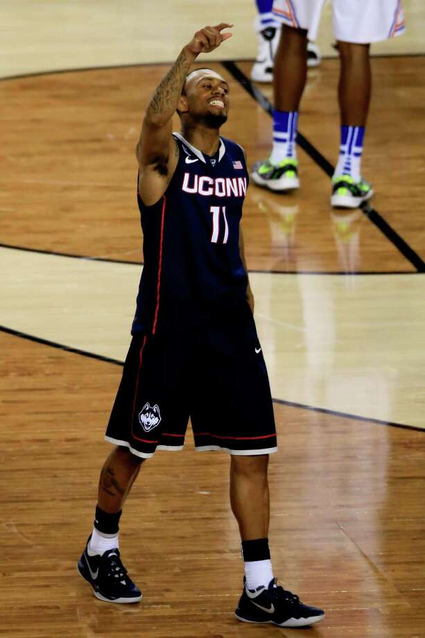 ARLINGTON, TX - APRIL 05:  Ryan Boatright #11 of the Connecticut Huskies celebrates after defeating the Florida Gators 63-53 in the NCAA Men's Final Four Semifinal at AT&T Stadium on April 5, 2014 in Arlington, Texas. Photo: Jamie Squire, Getty Images / Getty Images