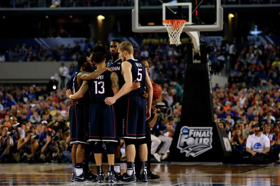 ARLINGTON, TX - APRIL 05: The Connecticut Huskies hudlde during the NCAA Men's Final Four Semifinal against the Florida Gators at AT&T Stadium on April 5, 2014 in Arlington, Texas. The Connecticut Huskies defeated the Florida Gators 63-53. Photo: Ronald Martinez, Getty Images / Getty Images