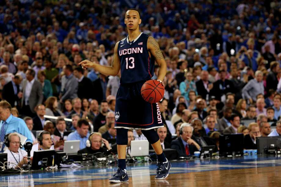 ARLINGTON, TX - APRIL 05: Shabazz Napier #13 of the Connecticut Huskies brings the ball up the floor against the Florida Gators during the NCAA Men's Final Four Semifinal at AT&T Stadium on April 5, 2014 in Arlington, Texas. Photo: Ronald Martinez, Getty Images / Getty Images