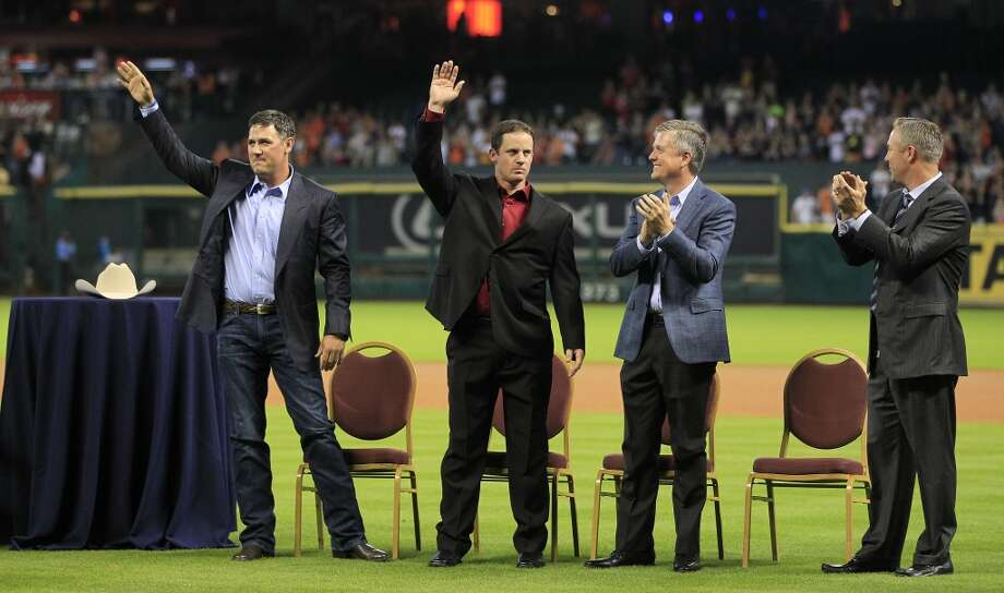 Lance Berkman and Roy Oswalt, who signed one-day contracts with the Astros wave to fans along with GM Jeff Luhnow and Reid Ryan. Photo: Karen Warren, Houston Chronicle