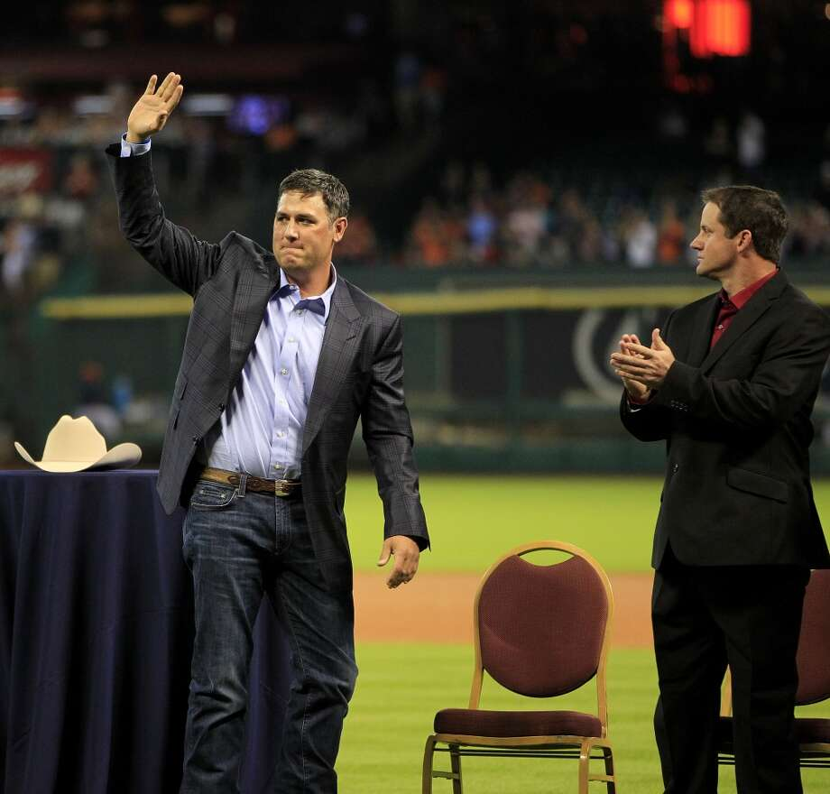 Lance Berkman and Roy Oswalt, who signed one-day contracts with the Astros, during a pre-game ceremony to honor them. Photo: Karen Warren, Houston Chronicle