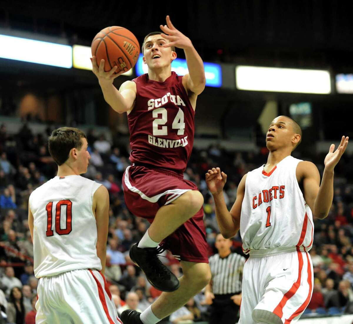 Scotia's Joe Cremo, center, goes to the hoop as Albany Academy's John Moutopoulos, left, and Ray Jerome defend during their Federation Class A basketball semifinal on Friday, March 21, 2014, at Times Union Center in Albany, N.Y. (Cindy Schultz / Times Union)