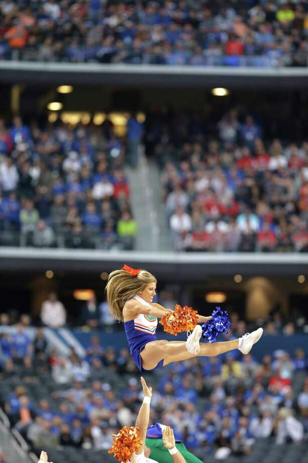 Florida cheerleaders perform during the first half of an NCAA Final Four tournament college basketball semifinal game against Connecticut Saturday, April 5, 2014, in Arlington, Texas. (AP Photo/Eric Gay) Photo: Eric Gay, Associated Press / AP