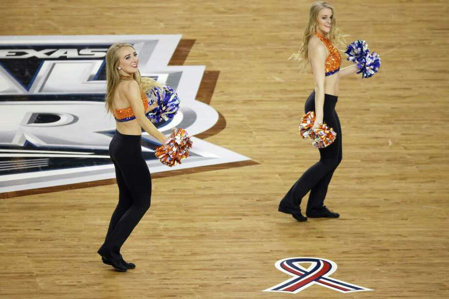 Florida cheerleaders perform during the first half of an NCAA Final Four tournament college basketball semifinal game against Connecticut Saturday, April 5, 2014, in Arlington, Texas. (AP Photo/Tony Gutierrez) Photo: Tony Gutierrez, Associated Press / AP