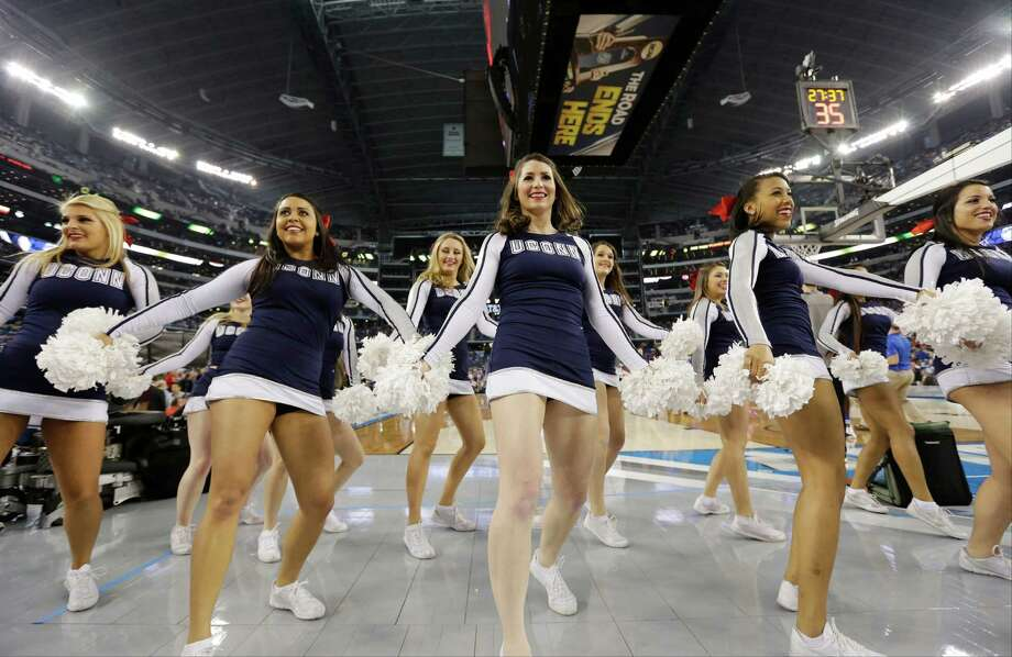 Connecticut cheerleaders perform before an NCAA Final Four tournament college basketball semifinal game against Florida Saturday, April 5, 2014, in Arlington, Texas. (AP Photo/Eric Gay) Photo: Eric Gay, Associated Press / AP