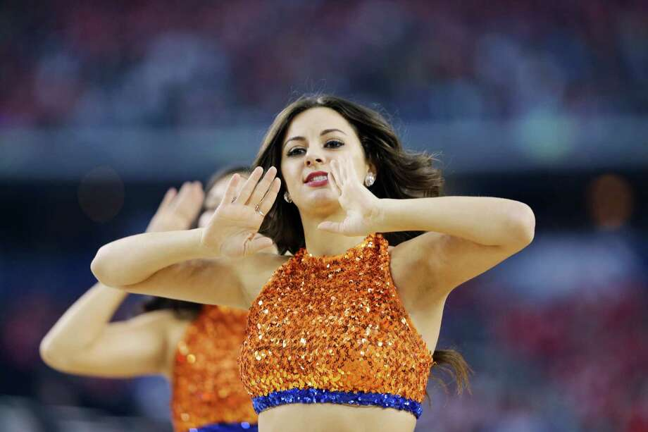 Florida cheerleaders perform during the first half of the NCAA Final Four tournament college basketball semifinal game against Connecticut Saturday, April 5, 2014, in Arlington, Texas. (AP Photo/David J. Phillip) Photo: David J. Phillip, Associated Press / AP