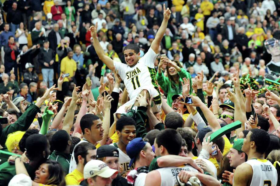 Siena fans lift Steven Cruz, center, as they celebrate their 81-68 win over Fresno State in the CBI final game on Saturday, April 5, 2014, at the Alumni Recreation Center in Loudenville, N.Y. (Cindy Schultz / Times Union) Photo: Cindy Schultz / 00026315B