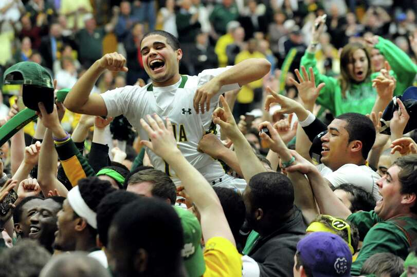 Siena fans lift Steven Cruz, center, as they celebrate their 81-68 win over Fresno State in the CBI