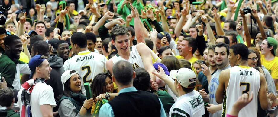 Siena's Rob Poole, center, celebrates their 81-68 win with teammates and fans in the CBI final game against Fresno State on Saturday, April 5, 2014, at the Alumni Recreation Center in Loudenville, N.Y. (Cindy Schultz / Times Union) Photo: Cindy Schultz / 00026315B