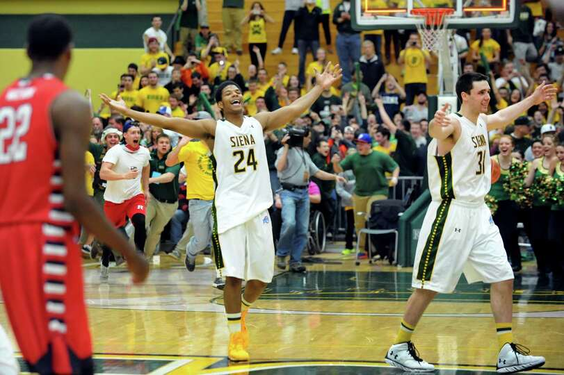 Siena's Lavon Long, center, and Brett Bisping, right, celebrate their 81-68 win over Fresno State as