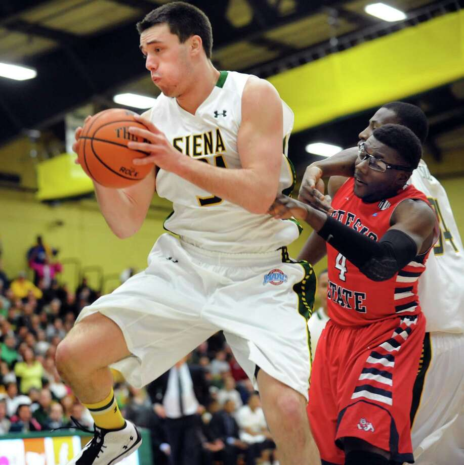 Siena's Brett Bisping, left, gets the rebound as Fresno State's Karachi Edo defends in the CBI final basketball game on Saturday, April 5, 2014, at the Alumni Recreation Center in Loudenville, N.Y. (Cindy Schultz / Times Union) Photo: Cindy Schultz / 00026315B
