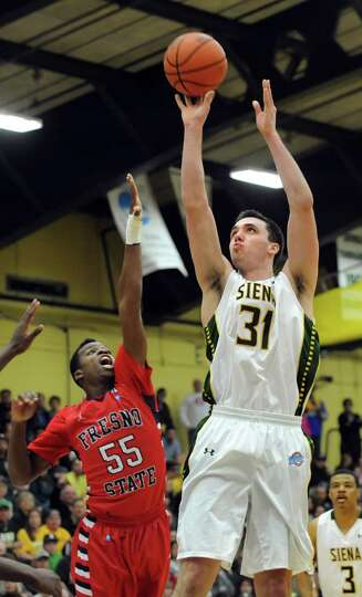 Siena's Brett Bisping, right, shoots for the hoop as Fresno State's Allen Huddleston defends in the