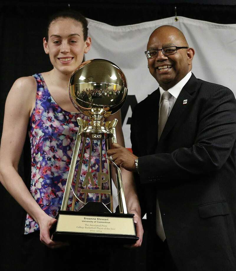 Connecticut sophomore Breanna Stewart accepts the Associated Press Player of the Year trophy Saturday. Photo: Mark Humphrey / Associated Press / AP