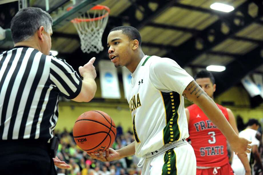 Siena's Marquis Wright, right, disputes an official's call in the CBI final basketball game against Fresno State on Saturday, April 5, 2014, at the Alumni Recreation Center in Loudenville, N.Y. (Cindy Schultz / Times Union) Photo: Cindy Schultz / 00026315B