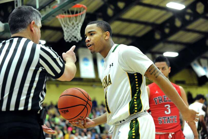 Siena's Marquis Wright, right, disputes an official's call in the CBI final basketball game against