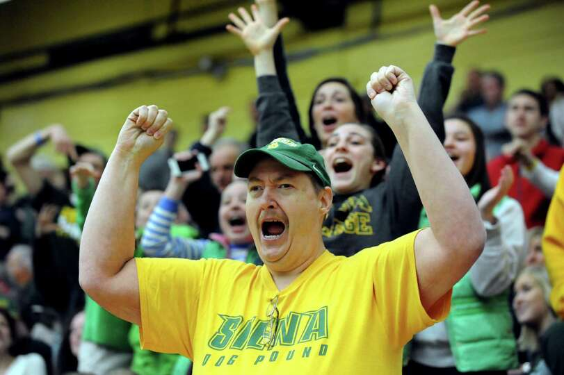 Siena' season ticket holder Bill Springer cheers in the CBI final basketball game against Fresno Sta