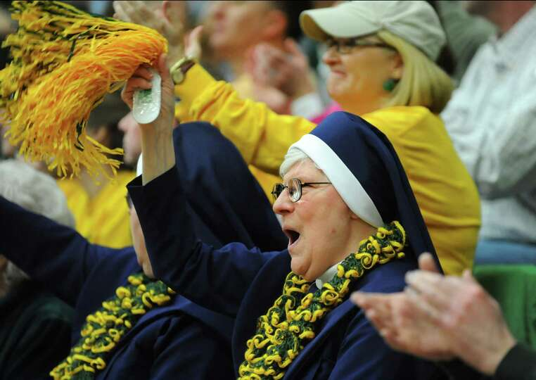 Siena fan Sister Mary Stephen cheers in the CBI final basketball game against Fresno State on Saturd