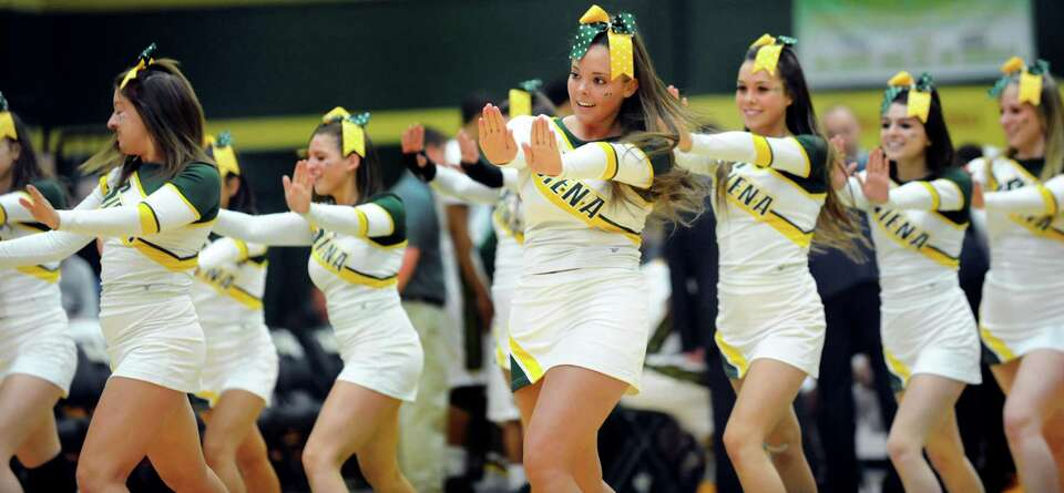 Siena cheer team takes the floor in the CBI final basketball game against Fresno State on Saturday,