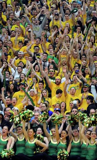Siena's student section cheers on their team in the CBI final basketball game against Fresno State o