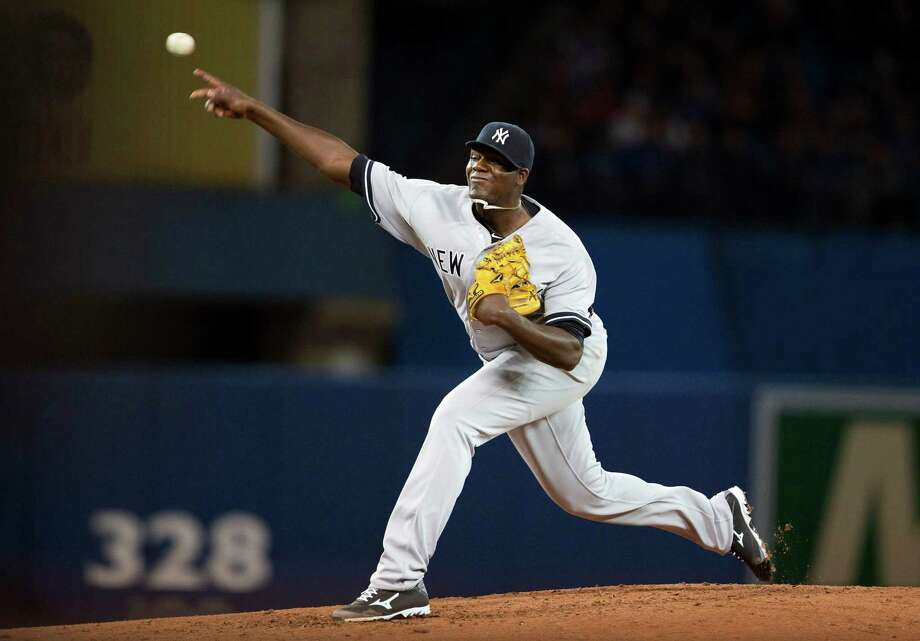 New York Yankees starting pitcher Michael Pineda delivers a pitch during the third inning of a baseball game in Toronto on Saturday, April 5, 2014. (AP Photo/The Canadian Press, Peter Power) ORG XMIT: PMP107 Photo: Peter Power / The Canadian Press