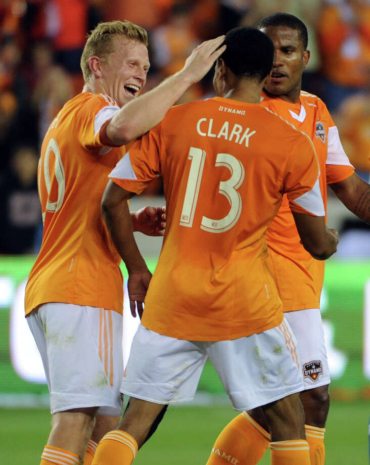 Houston's Ricardo Clark (13) celebrates his equalizing goal in the 41st minute with teammate Andrew Driver, left, during the first half of an MLS soccer game against FC Dallas, Saturday, April 5, 2014, at BBVA Compass Stadium in Houston. Photo: Eric Christian Smith, For The Chronicle