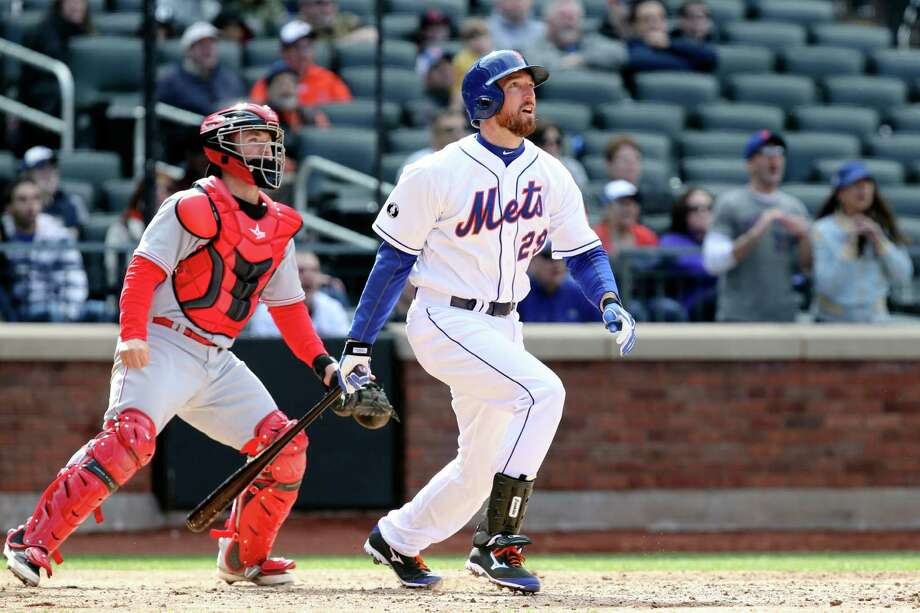 New York Mets first baseman Ike Davis (29) hits a walk-off grand slam in the ninth inning of a baseball game against the Cincinnati Reds at Citi Field, Saturday, April 5, 2014, in New York. The Mets won 6-3. (AP Photo/John Minchillo) ORG XMIT: NYJM117 Photo: John Minchillo / FR170537 AP