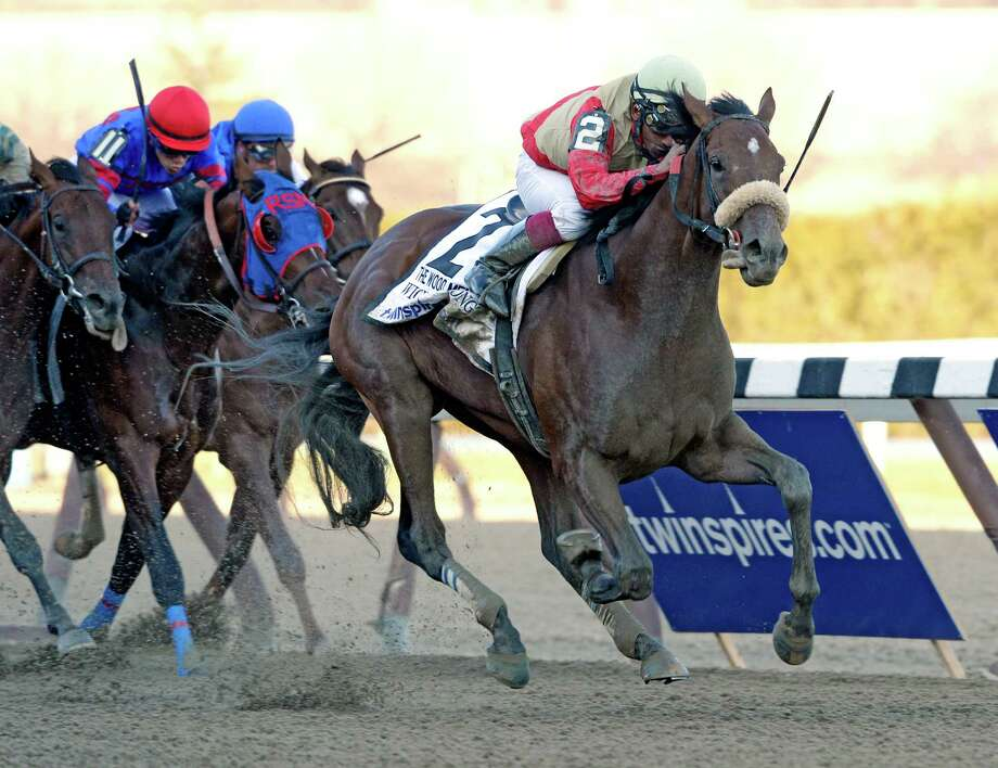 Centennial Farm's Wicked Strong with jockey Rajiv Maragh aboard wins the 90th running of the Wood Memorial April 5, 2014 at Aqueduct Park in Ozone Park, N.Y.     (Skip Dickstein / Times Union) Photo: SKIP DICKSTEIN