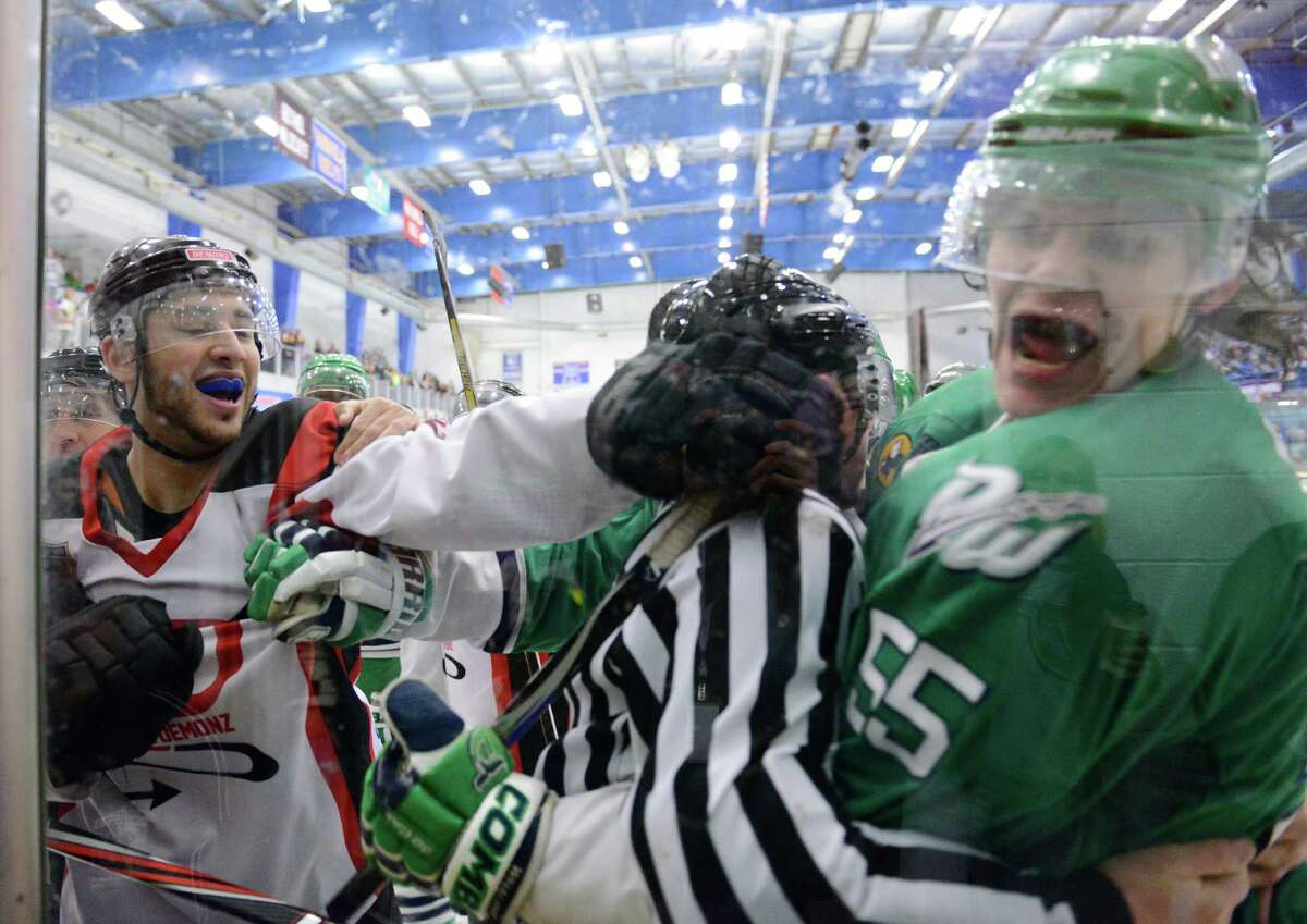 Dayton's Brandon Blair, left, goes after Danbury's Julian Fraser, being held back by a referee, after both players were called for roughing in game one of the Federal Hockey League Commissioner's Cup finals between the Danbury Whalers and the Dayton Demonz at Danbury Ice Arena in Danbury, Conn. Saturday, April 5, 2014.