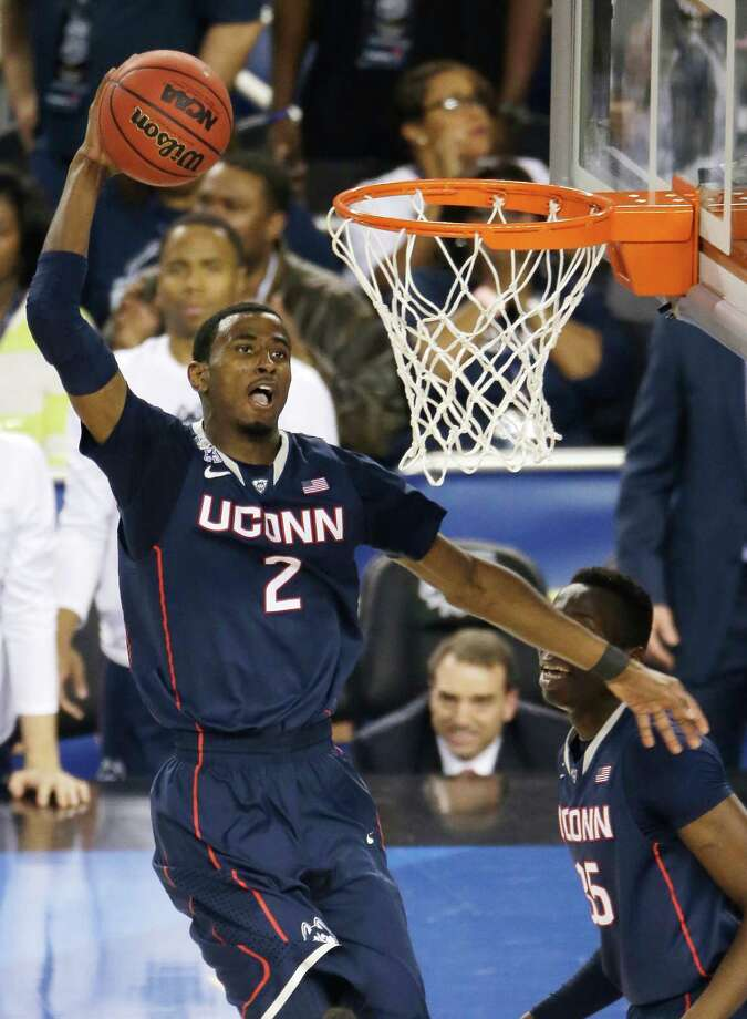 Connecticut forward DeAndre Daniels dunks the ball during the second half of the NCAA Final Four tournament college basketball semifinal game against Florida Saturday, April 5, 2014, in Arlington, Texas. (AP Photo/Tony Gutierrez)  ORG XMIT: FF334 Photo: Tony Gutierrez / AP