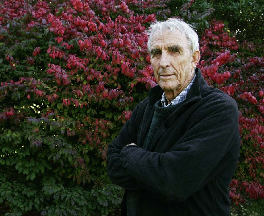 FILE - Writer Peter Matthiessen stands in the yard of his house in Sagaponack, N.Y. in this Oct. 28, 2004 file photo. Matthiessen, award-winning author of more than thirty books, world-renowned naturalist, explorer, Buddhist teacher, and political activist, died Saturday, April 5, 2014 after an illness of some months,according to his publisher Geoff Kloske of Riverhead Books. He was 86.  (AP Photo/Ed Betz, File) Photo: ED BETZ, STR / AP