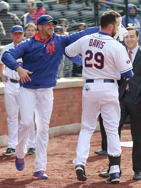 Ike Davis, right, was more than happy to take a shaving-cream pie to the face after belting a walkoff grand slam in the Mets' win over the Reds on Saturday. Photo: John Minchillo, FRE / FR170537 AP