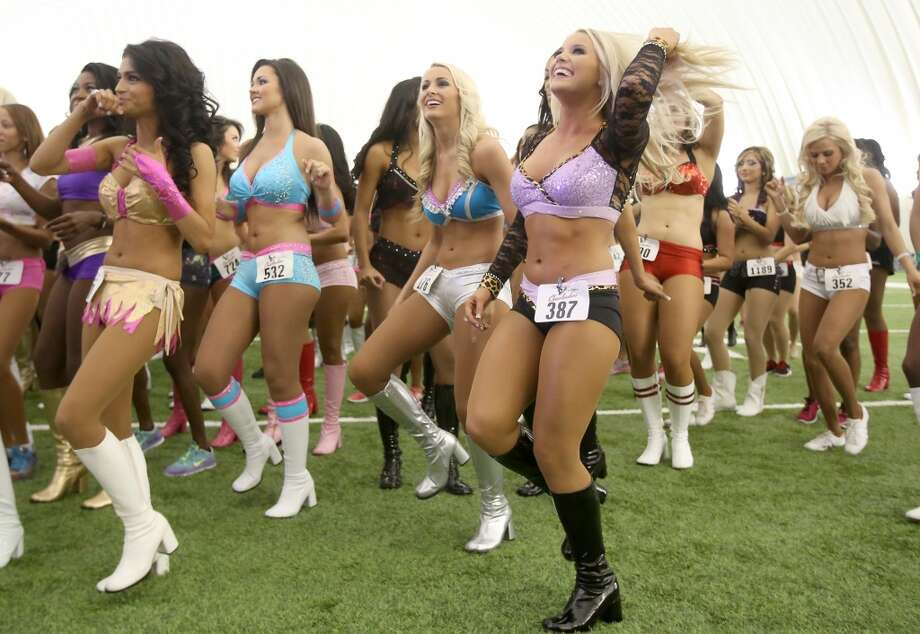 4/5/14: Former Texans cheerleaders dance before the tryouts. Ladies wearing a variety of outfits and ranging from 18 years of age into thither 30's tried out for the 2014-15 Houston Texas Cheerleading Team at the practice bubble on the Houston Texans grounds in Houston, Texas. Music was provided by DJ Ran. Photo: Thomas B. Shea