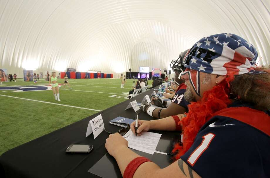 4/5/14: Ultimate Fan Steve Beckholt judges ladies as they try out to be a Houston Texans Cheerleader.Ladies wearing a variety of outfits and ranging from 18 years of age into thither 30's tried out for the 2014-15 Houston Texas Cheerleading Team at the practice bubble on the Houston Texans grounds in Houston, Texas. Music was provided by DJ Ran. Photo: Thomas B. Shea